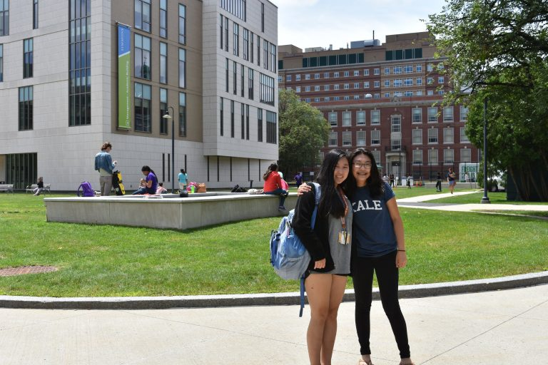 Students pose in the Simmons University courtyard