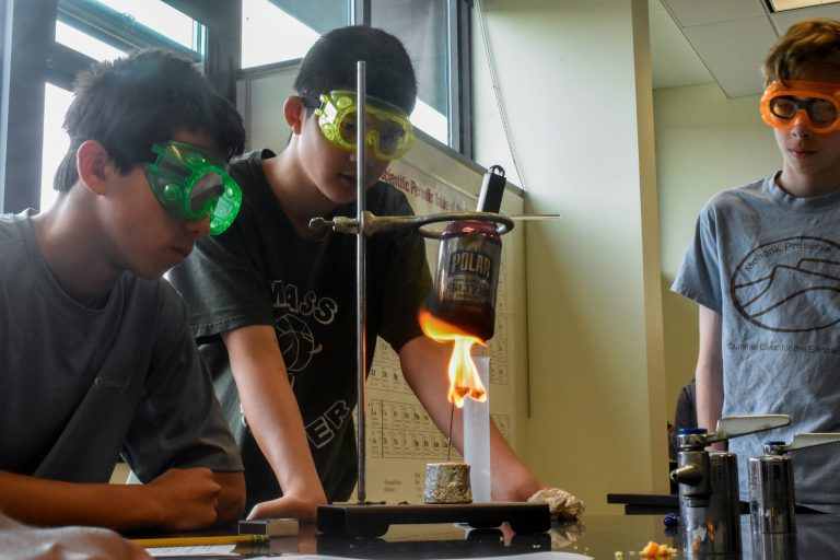 Students perform an experiment in the Chemistry Edge program