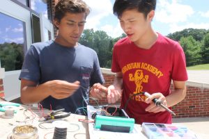 Students do Arduino robotics work in the Engineering Research three-week program
