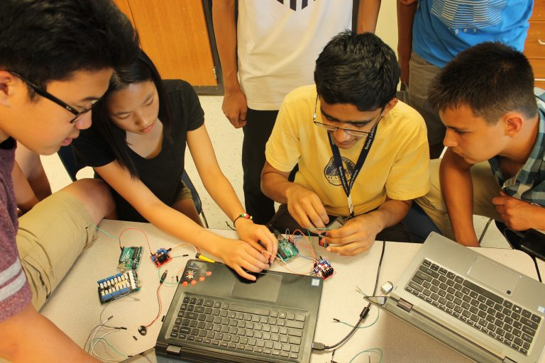 Students program an Arduino device in the Engineering Research three-week program