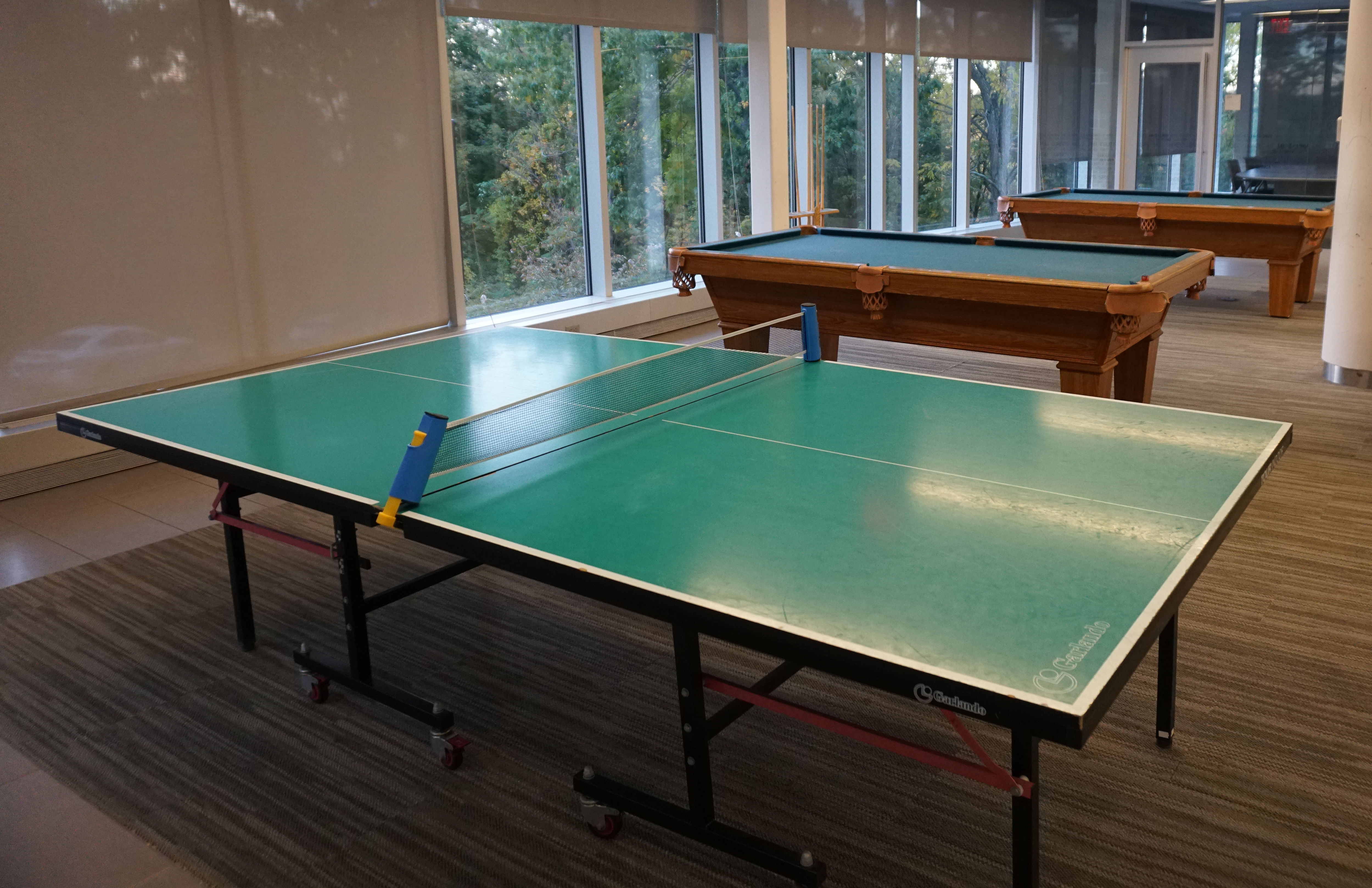 Table tennis and pool tables at Bentley University's student activities center