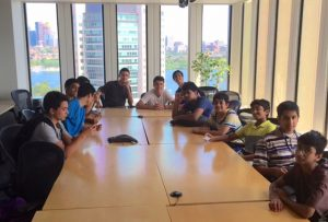 Students sit in a conference room from a STEM Entrepreneurship field trip