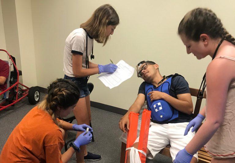 Students perform a mock medical procedure in the Emergency Medicine three-week program