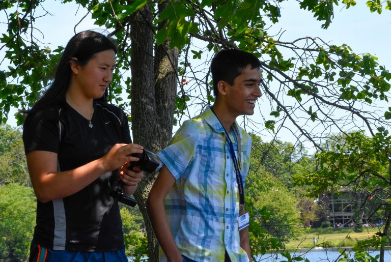 Students testing the remote-controlled boats they built in the Engineering Research program
