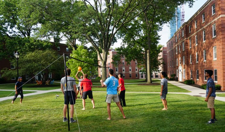 Day students play volleyball in the Longwood University dorms courtyard