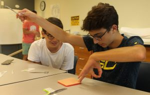 Students performing an experiment in Sports Medicine one-week program
