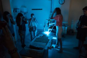 Students do a black light forensic examination in the Forensics one-week program