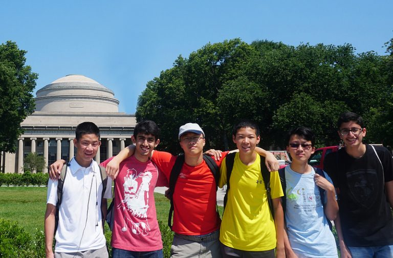 Students pose in front of the MIT dome in the Applied Physics and Engineering three-week summer program