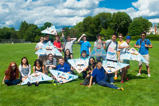Students show off the remote-controlled airplanes they built in the Applied Physics and Engineering three-week summer program