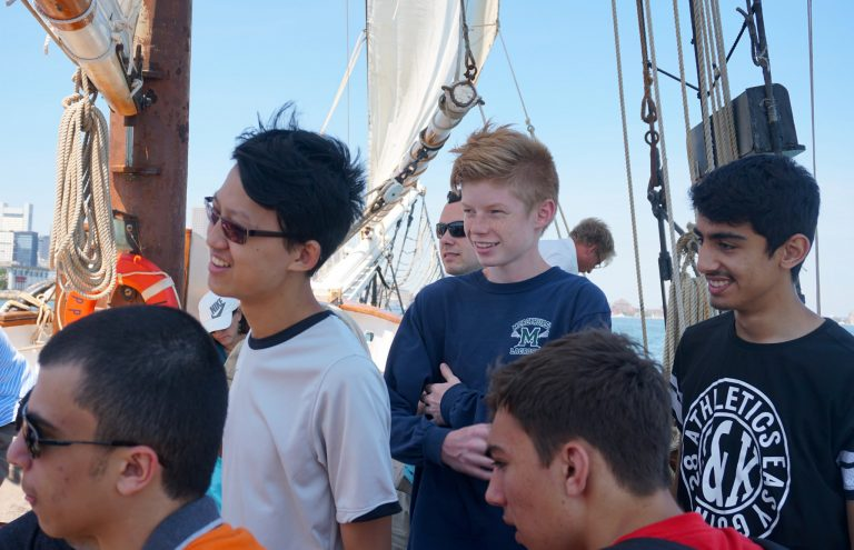 Students take a boat ride on the Boston Harbor in the Engineering Research three-week summer program