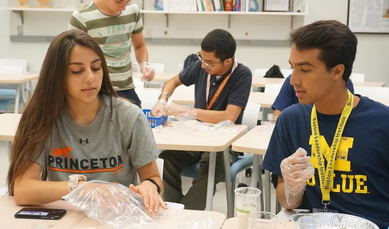 Student does an experiment in the Chemistry Research three-week summer science program