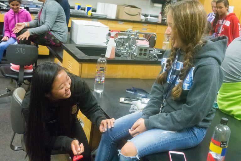 Students do a reflex test in the Pediatrics one-week medical program