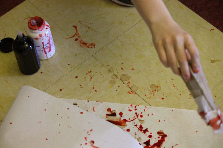 Students set up a mock crime scene in the Forensic Science three-week summer science program