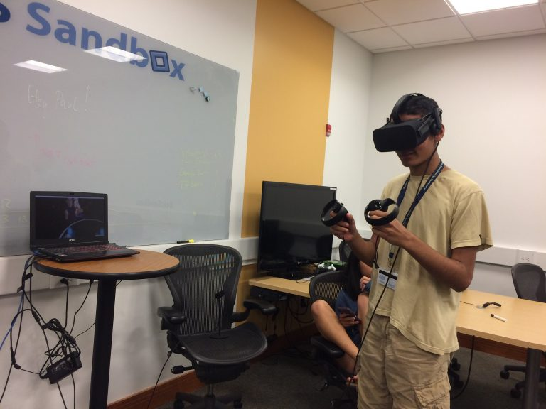 Students use VR equipment in the Big Data one-week summer business program