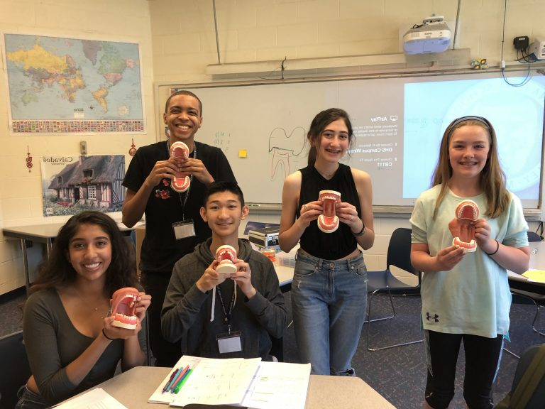 Students pose with teeth models in the Anatomy one-week summer medical program