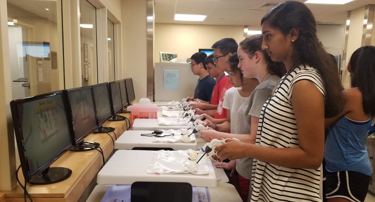 Students do an experiment in the Anatomy and Surgical Research three-week summer medical program