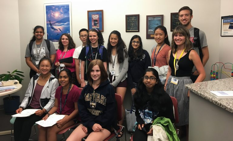 Autumn Becker poses with students
