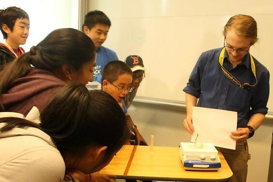 Students watch an experiment in the Biomedical Engineering three-week summer engineering program