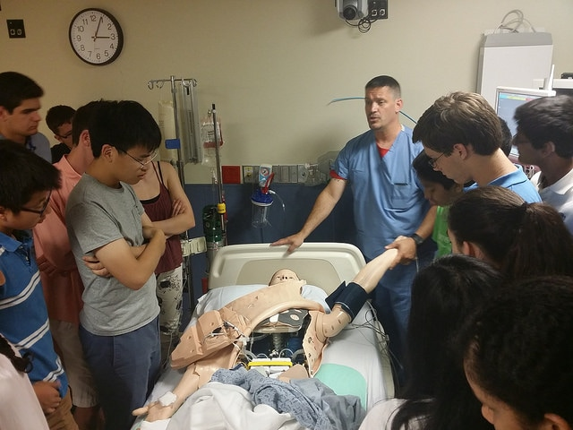 Students view a mock-surgery in the Biomedical and Surgical Research three-week summer program