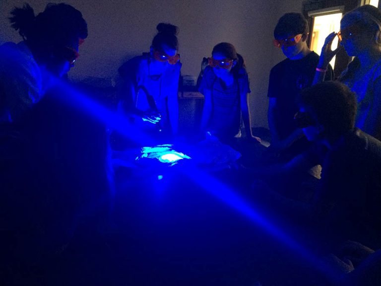Students do an experiment in the Forensic Science three-week summer science program