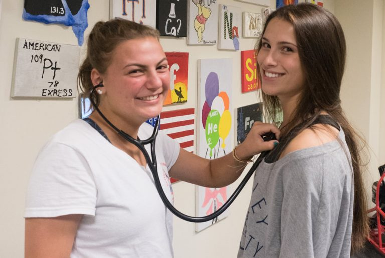 Students do tests with a stethoscope in the Emergency Medicine three-week summer medical programs