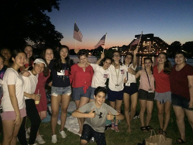 Students take a picture in Boston at night