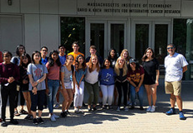 Ken Bateman poses with his students in front of the MIT museum