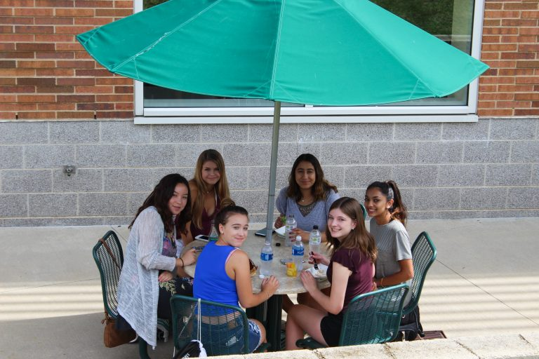 Students eat lunch outside in the Longwood Medical Area