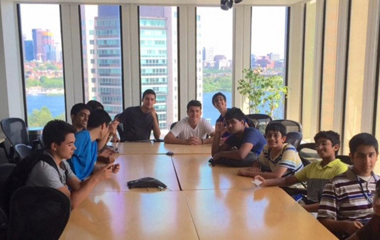 Students visit a board room at Babson College in the STEM Entrepreneurship three-week science program
