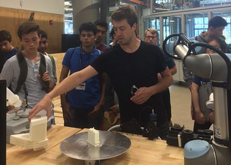 Students watch a demonstration on a field trip in the STEM Entrepreneurship three-week summer science program