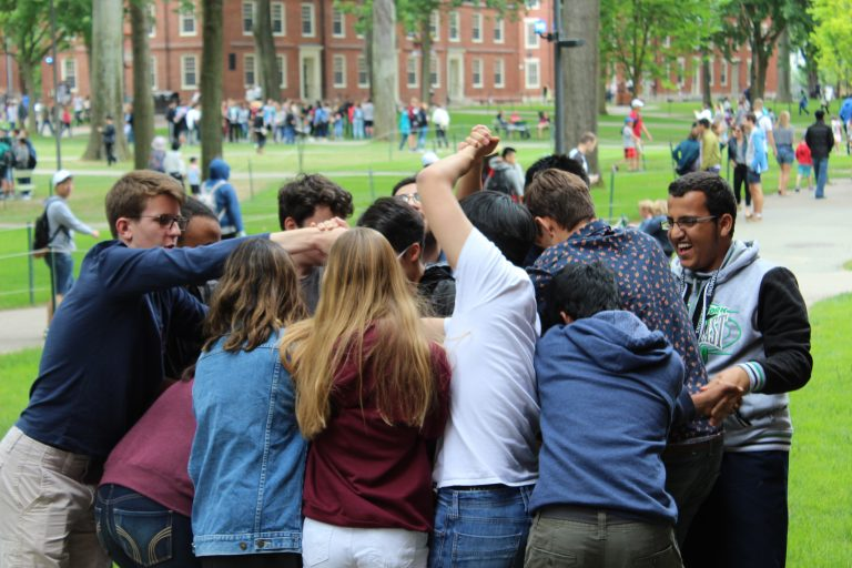 Students have a group hug at the Simmons University dorms