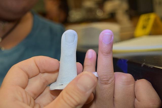 Students do fingerprint testing in the Forensic Science three-week summer science program