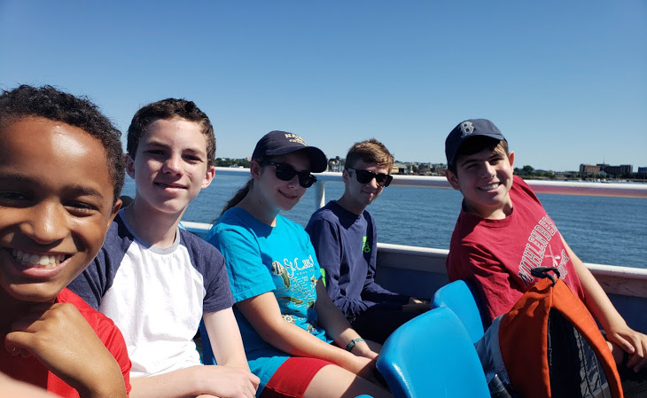 Students go on a boat ride in Boston Harbor in the Marine Biology one-week summer science program