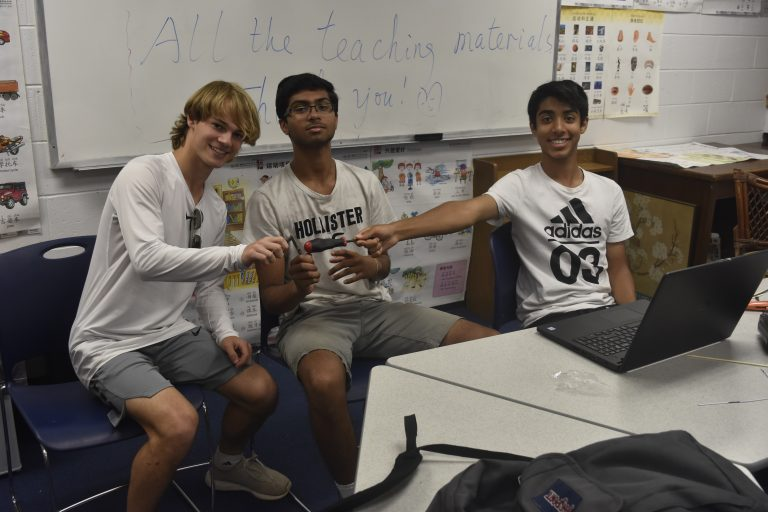 Students building remote-controlled planes in the Applied Physics and Engineering three-week summer engineering program