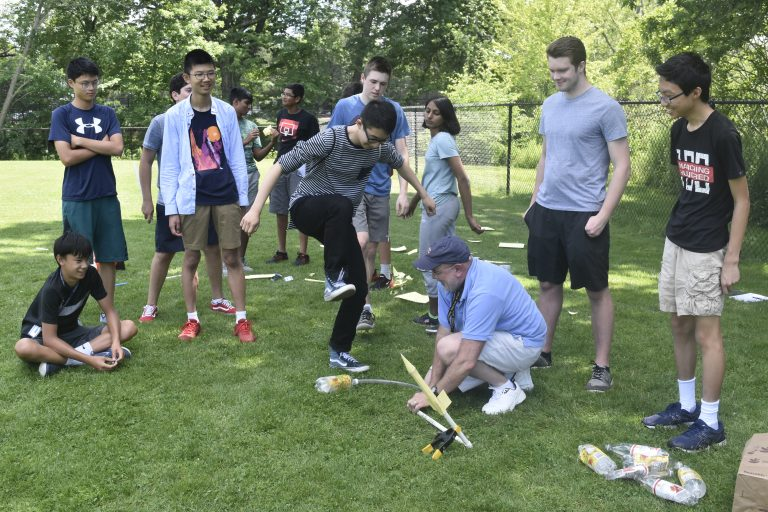 Students test out rockets that they built in the Applied Physics and Engineering three-week summer engineering program