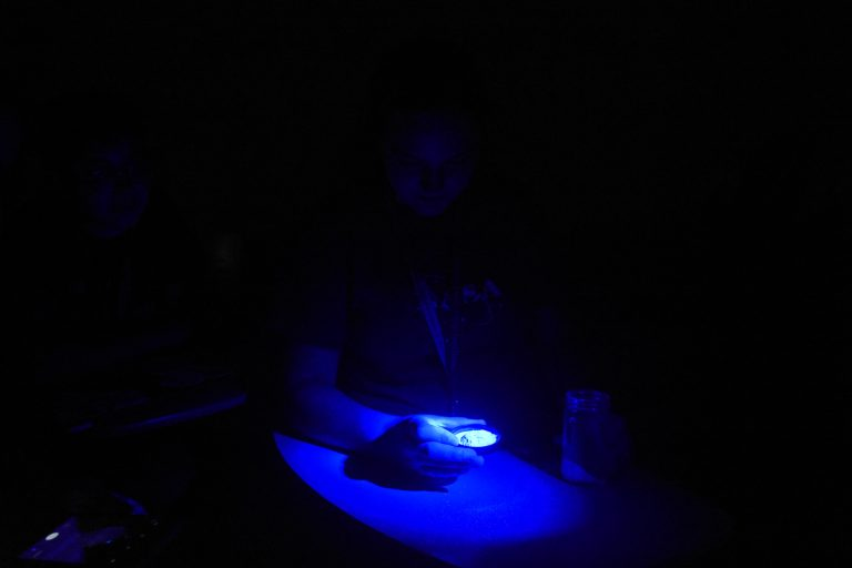Student does an experiment in the Forensic Science three-week summer science program