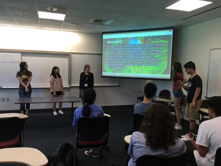 Students present their findings in the Biomedical Research: Genetics and Clinical Trials three-week summer medical program