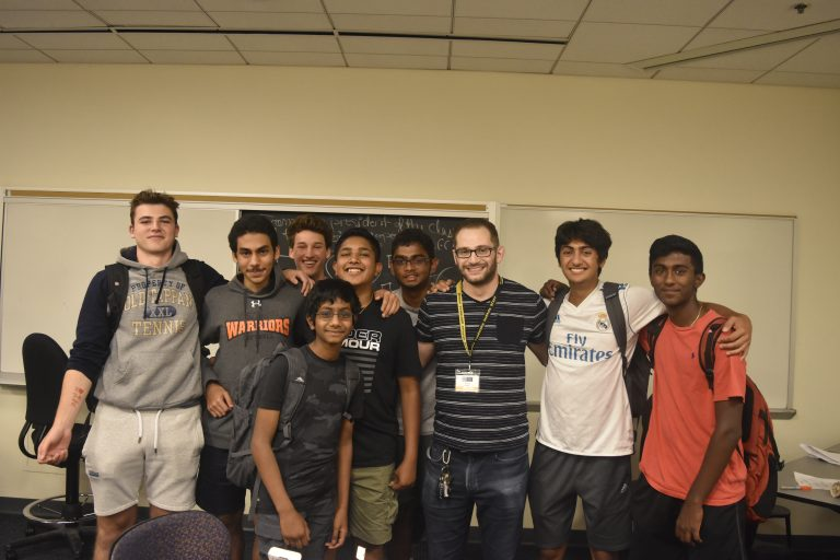 Students pose with teacher Jeff Robin in the Biomedical and Surgical Research three-week summer program