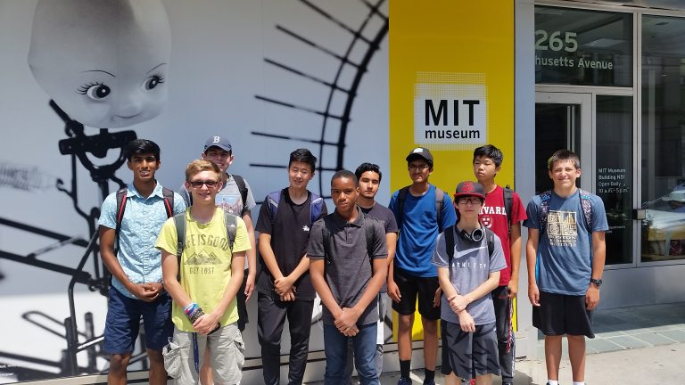 Students pose in front of the MIT Museum on a field trip in the Engineering Research three-week summer engineering program