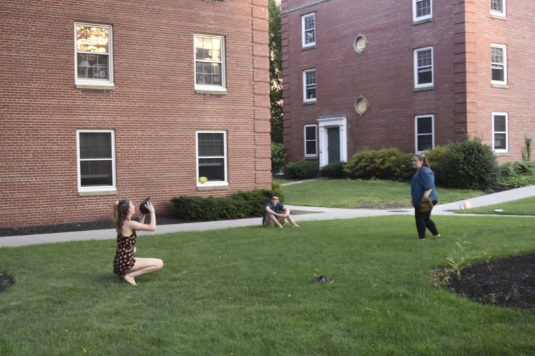 Students relax in the courtyard at the Longwood campus