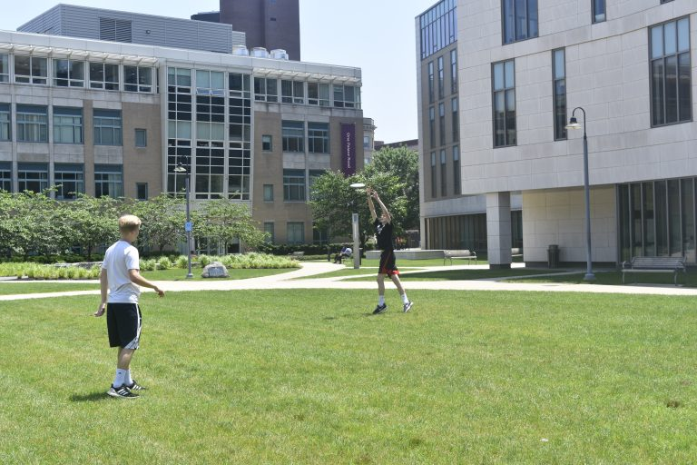 Students play Frisbee in the Longwood campus
