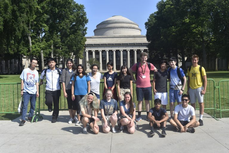 Students pose in front of MIT in the Chemistry Research three-week summer science program