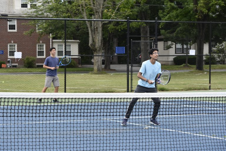 Students play tennis at the Dana Hall School campus tennis courts