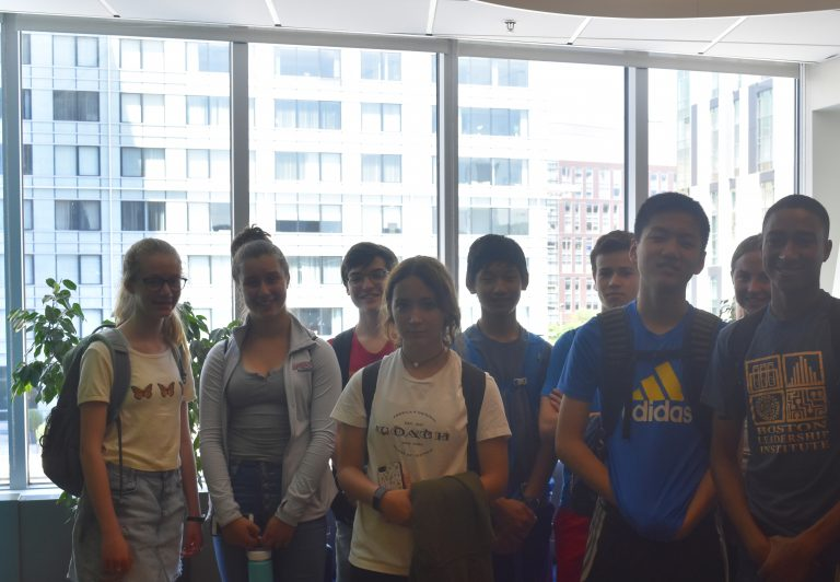 Students pose for a photo at the Fidelity Boston Office in the STEM Entrepreneurship three-week summer business program