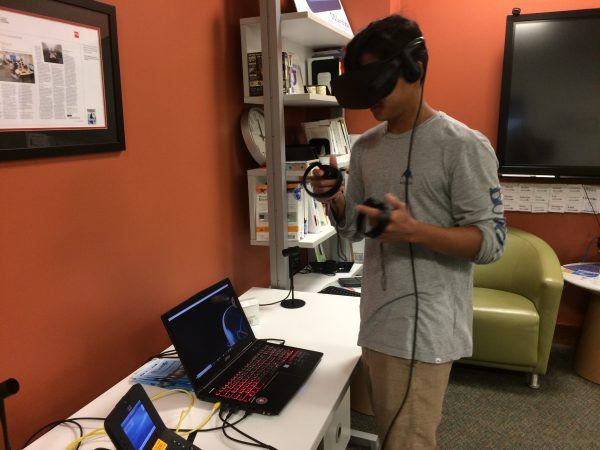 Student uses a virtual reality headset in the Big Data one-week program