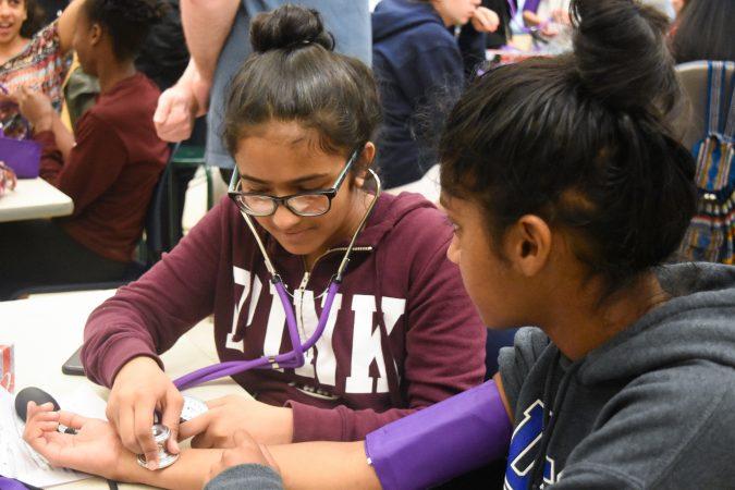 Students do a mock examination in the Pediatrics one-week program
