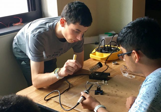 Students build a robot in the Electronics and Robotics three-week program
