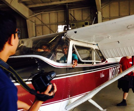 Students go on a field trip and view a plane in the Physics Edge one-week program